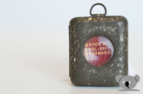 Decorated tin locket for the world's smallest dictionary